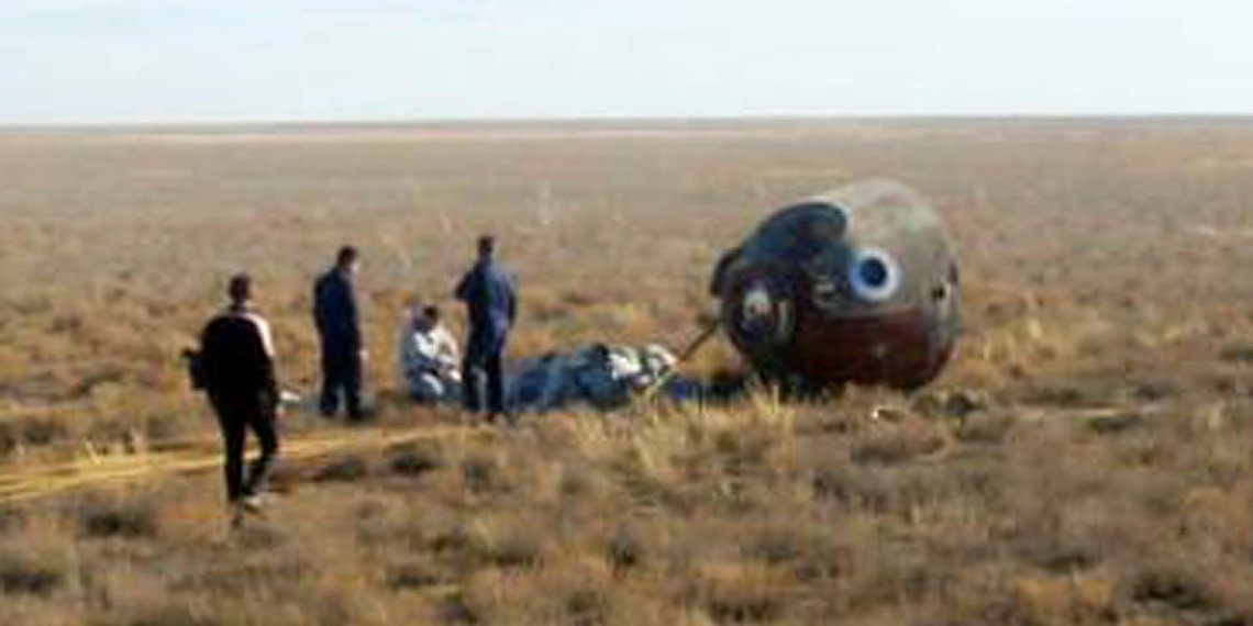 """Specialists gather near the Soyuz capsule transporting U.S. astronaut Nick Hague and Russian cosmonaut Alexei Ovchinin, after it made an emergency landing following a failure of its booster rockets, near the city of Zhezkazgan in central Kazakhstan October 11, 2018. Federal Air Transport Agency """"Rosaviation""""/Handout via REUTERS. ATTENTION EDITORS - THIS PICTURE WAS PROVIDED BY A THIRD PARTY. NO RESALES. NO ARCHIVES."""