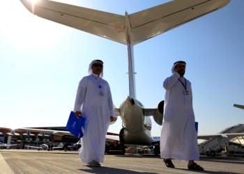 FILE PHOTO: Visitors walk past aircraft on display during the Middle East Business Aviation show at Al Maktoum International Airport in Dubai World Central, December 11, 2012. REUTERS/Jumana El Heloueh