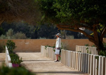 A woman visits graves of World War Two soldiers before a ceremony for the anniversary of the Battle of El Alamein, at El Alamein war cemetery in Egypt, October 20, 2018. REUTERS/Amr Abdallah Dalsh