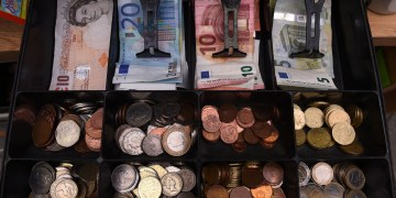FILE PHOTO: A shop cash register is seen with both Sterling and Euro currency in the till at the border town of Pettigo, Ireland October 14, 2016. REUTERS/Clodagh Kilcoyne
