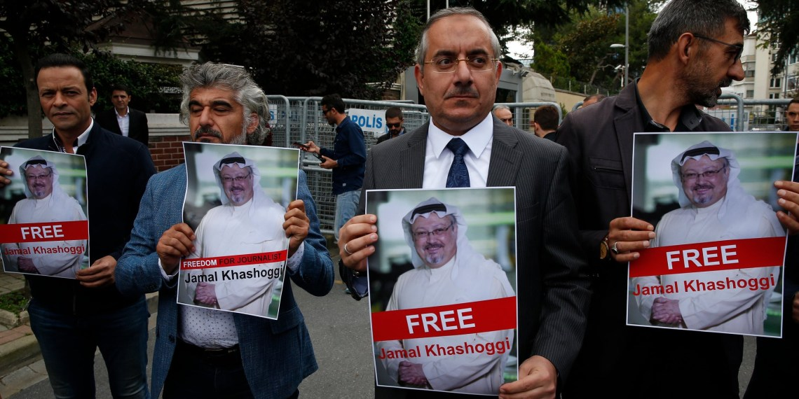 Members of a Turkish-Arab journalists association holding posters of Jamal Khashoggi at a protest on Monday near the Saudi consulate in Istanbul.