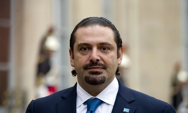 Former Lebanese prime minister Saad Hariri leaves at the end of a meeting with the French president at the Elysee Palace in Paris on October 7, 2014. AFP PHOTO/ ALAIN JOCARD