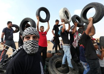 Tires are a favored item by Gaza demonstrators during the weekly protests — they are set on fire, then tossed toward Israeli troops across the border. (Reuters)
