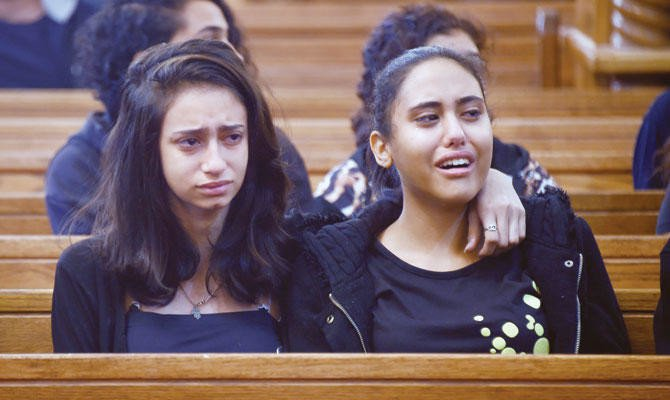 Women mourn Friday's terror attack victims at the church in Egypt's southern Minya province. (AFP)