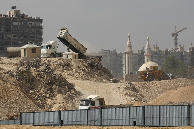 The Marota City project was approved in 2012 with a legislative law known as Decree No. 66, which authorized the government to redevelop slum dwellings and illegal housing areas in the Syrian capital. (AP)
