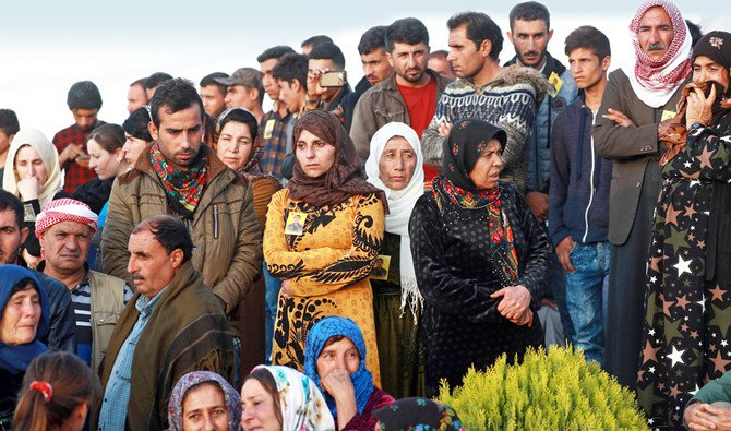 People attend the funeral of a fighter from the Syrian Democratic Forces in the northern Syrian town of Kobani. (AFP)