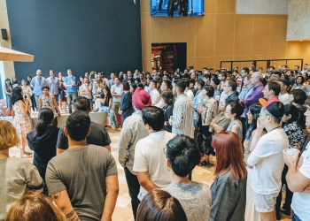 Google employees gather in a common area to attend the Google Walkout in Singapore, November 1, 2018 in this picture obtained from social media. Twitter @GOOGLEWALKOUT/Handout via REUTERS
