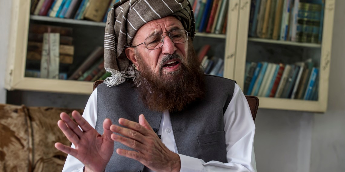 FILE PHOTO: Maulana Sami-ul Haq, a Pakistani cleric and head of Darul Uloom Haqqania, an Islamic seminary and alma mater of several Taliban leaders, talks during an interview with Reuters at his house in Akora Khattak, Khyber Pakhtunkhwa province September 14, 2013. REUTERS/Zohra Bensemra