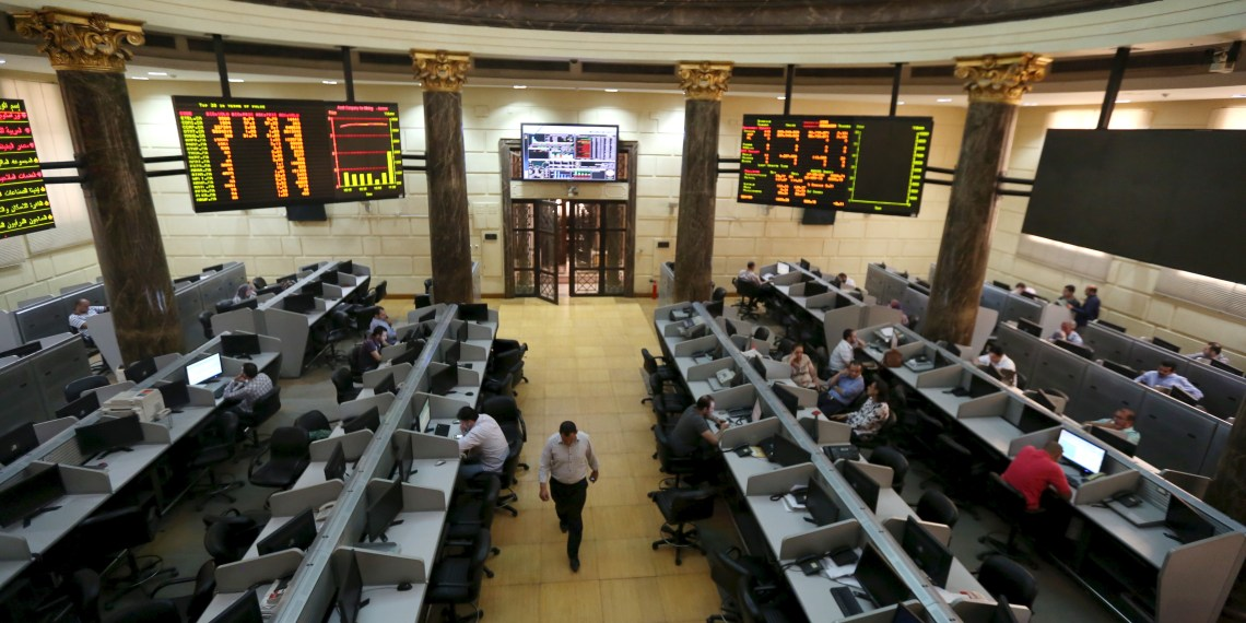 FILE PHOTO: Traders work at the Egyptian stock exchange in Cairo, May 28, 2015. REUTERS/Mohamed Abd El Ghany