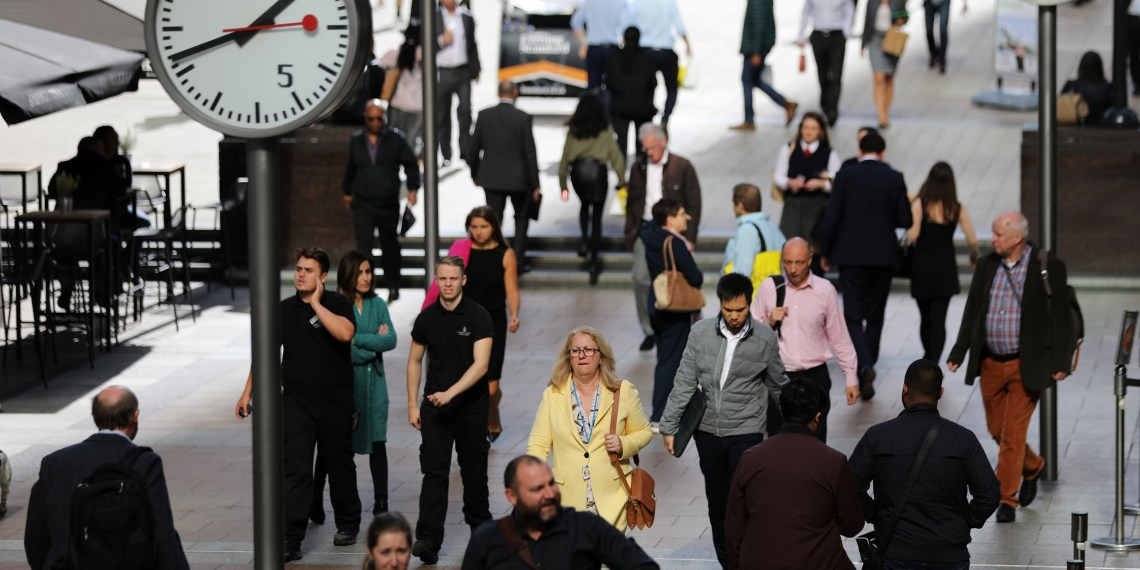 People walk through the financial district of Canary Wharf, London, Britain 28 September 2017. REUTERS/Afolabi Sotunde