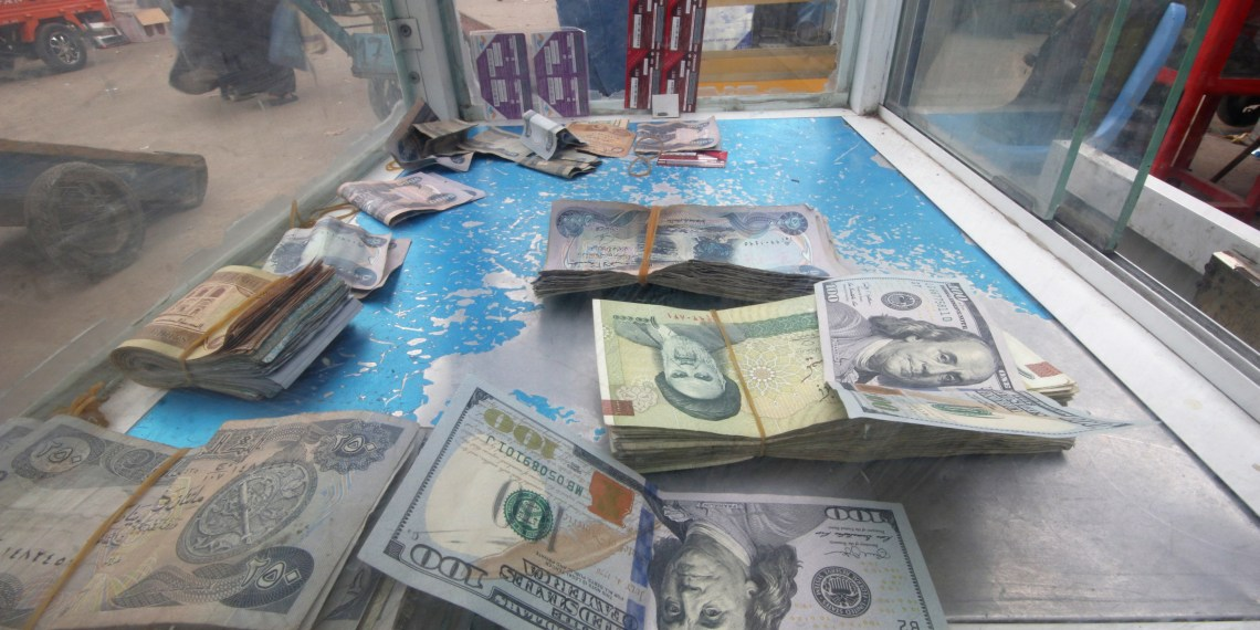 Iranian rials, U.S. dollars and Iraqi dinars are seen at a currency exchange shopÊin Basra, Iraq November 3, 2018. REUTERS/Essam al-Sudani