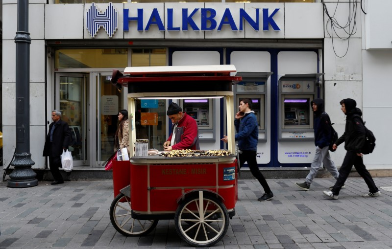 FILE PHOTO: A street vendor sells roasted chestnuts in front of a branch of Halkbank in central Istanbul, Turkey, January 10, 2018. REUTERS/Murad Sezer