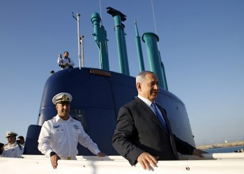 FILE PHOTO: Israeli Prime Minister Benjamin Netanyahu stands ona a navy submarine after it arrived in Haifa port, Israel January 12, 2016. REUTERS/Baz Ratner