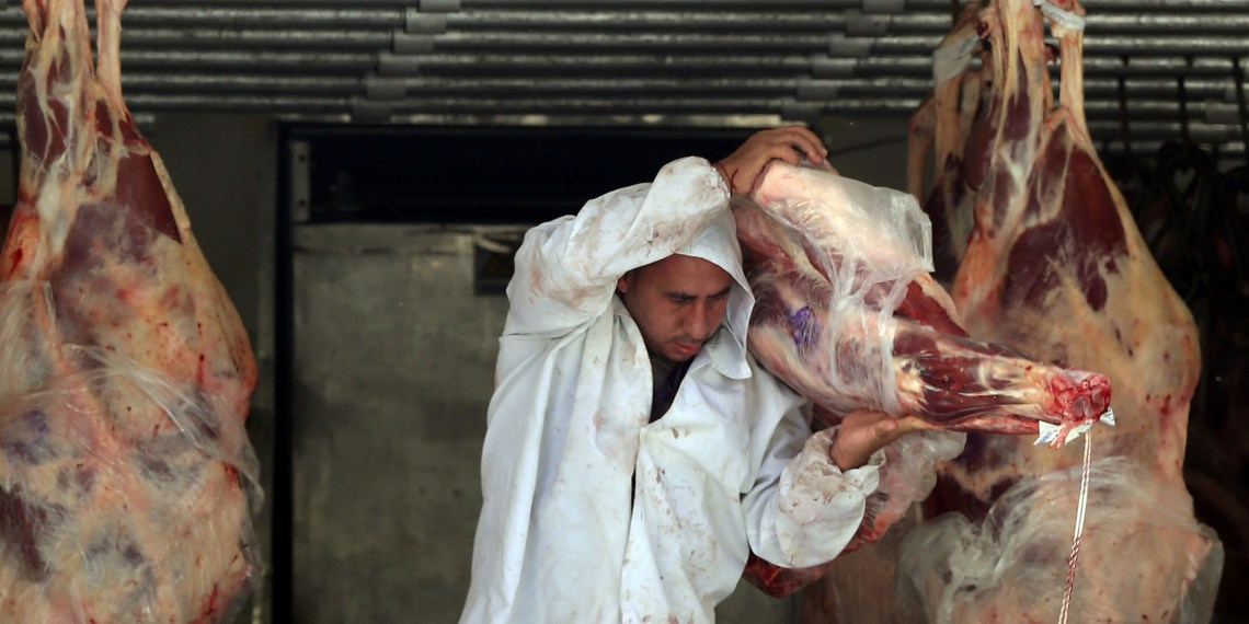FILE PHOTO: A butcher unloads beef from a truck outside a butcher's shop in Sao Paulo, Brazil July 27, 2017. REUTERS/Paulo Whitaker