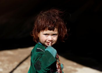 FILE PHOTO: An internally displaced Afghan child looks on at a refugee camp in Herat province, Afghanistan October 14, 2018. REUTERS/Mohammad Ismail