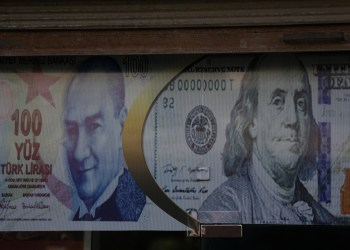 FILE PHOTO: Posters of U.S. dollar and Turkish lira are seen on a currency exchange shop in the city of Azaz, Syria August 18, 2018. REUTERS/ Khalil Ashawi
