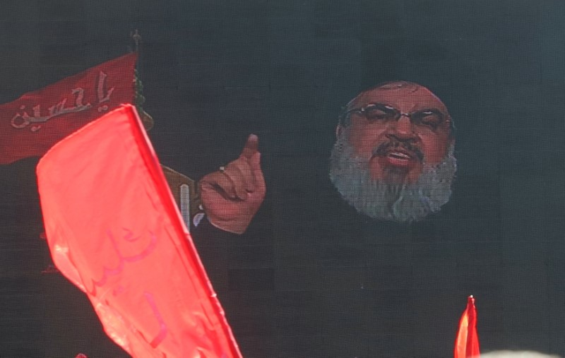 FILE PHOTO: Lebanon's Hezbollah leader Sayyed Hassan Nasrallah appears on a screen during a live broadcast as he speaks to his supporters during the ceremony of Ashura in Beirut, Lebanon October 1, 2017. REUTERS/Aziz Taher