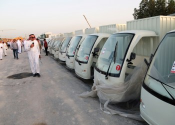 FILE PHOTO: A man looks at vehicles belonging to billionaire Maan al-Sanea and his company as they are auctioned by Saudi authorities in Dammam, Saudi Arabia March 18, 2018. REUTERS/Zuhair Al-Traifi