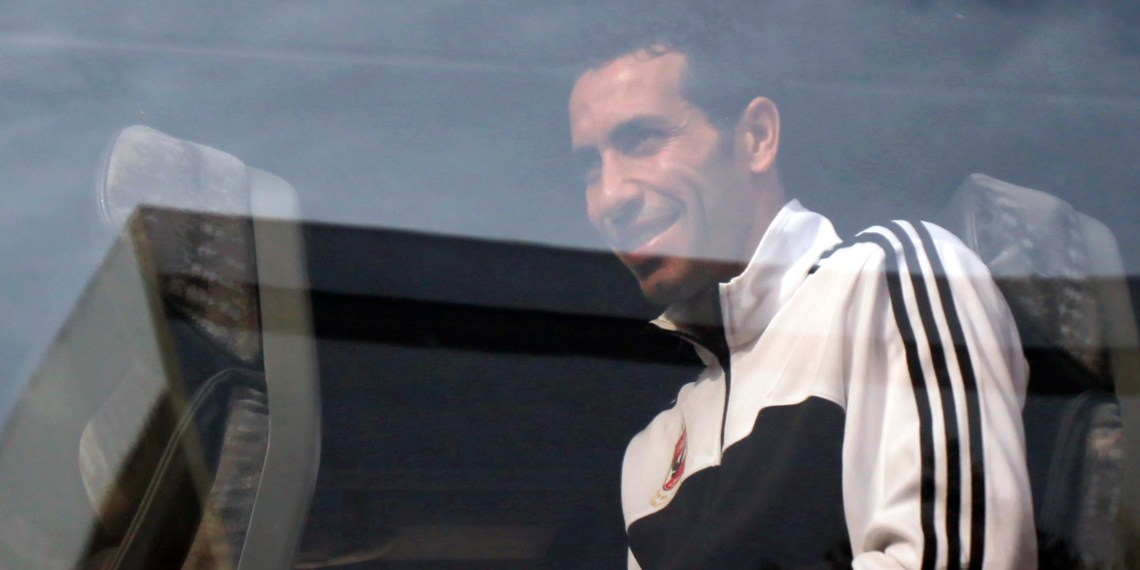 Mohamed Aboutrika of Egypt's Al Ahly smiles from the bus to fans after Friday prayers at Lebanon Mosque in Agadir, one of the host cities for the FIFA Club World Cup, December 13, 2013. The African champions Al Ahly will play their first game against China's Guangzhou Evergrande during their FIFA Club World Cup soccer match on December 14. REUTERS/Amr Abdallah Dalsh (MOROCCO - Tags: SPORT SOCCER RELIGION)
