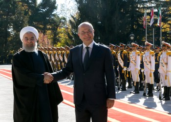 Iraq's President Barham Salih is welcomed by Iran's President Hassan Rouhani during his visit in Tehran, Iran, November 17, 2018. Official President website/Handout via REUTERS