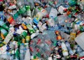 Plastic bottles and containers are seen in a container at a recycling park near Brussels, Belgium, November 20, 2018. REUTERS/Yves Herman