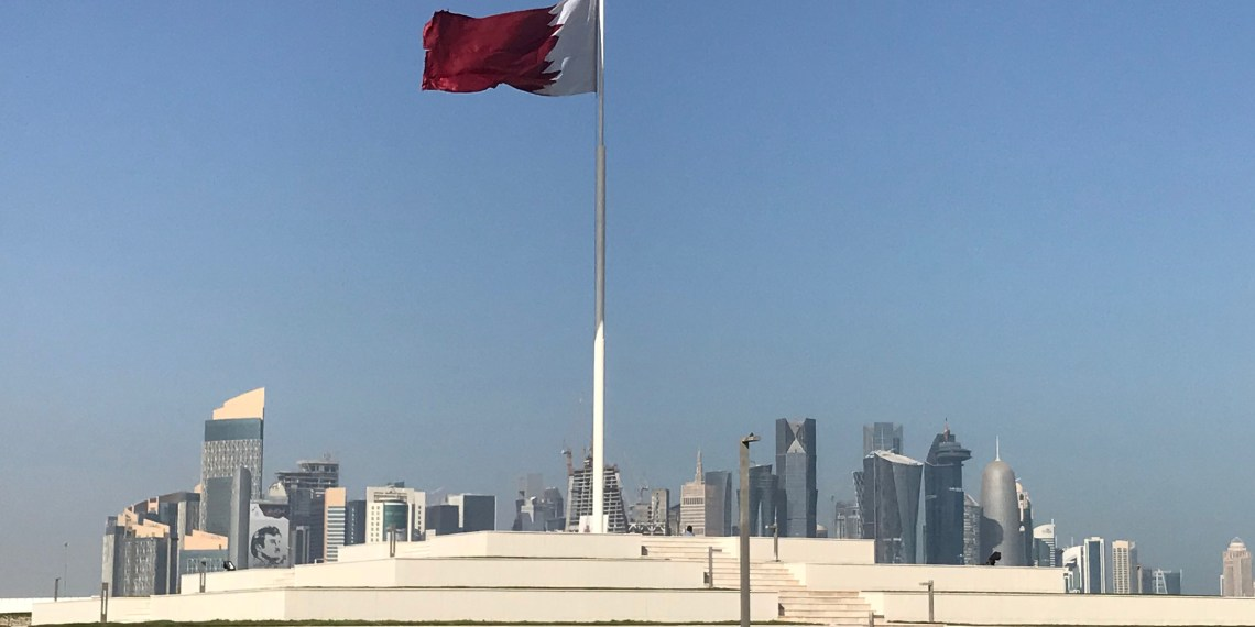 FILE PHOTO: The Qatari flag is seen at a park near Doha Corniche, in Doha, Qatar February 17, 2018. Picture taken February 17, 2018. REUTERS/Ibraheem al Omari