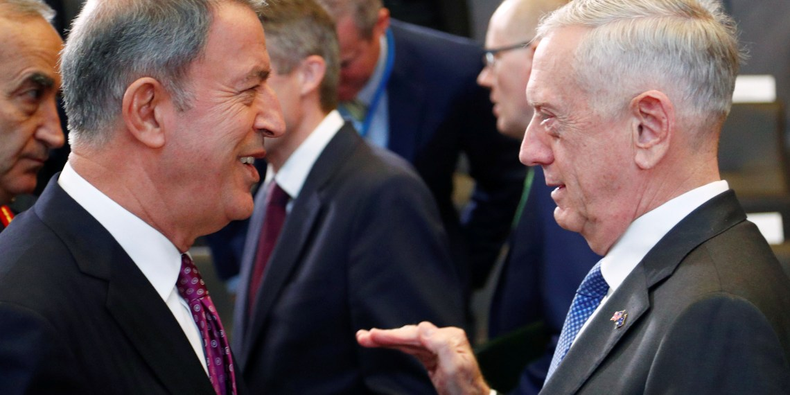 FILE PHOTO: Turkey's Defence Minister Hulusi Akar talks with U.S. Secretary of Defense Jim Mattis during a NATO defence ministers meeting at the Alliance headquarters in Brussels, Belgium, October 4, 2018. REUTERS/Francois Lenoir