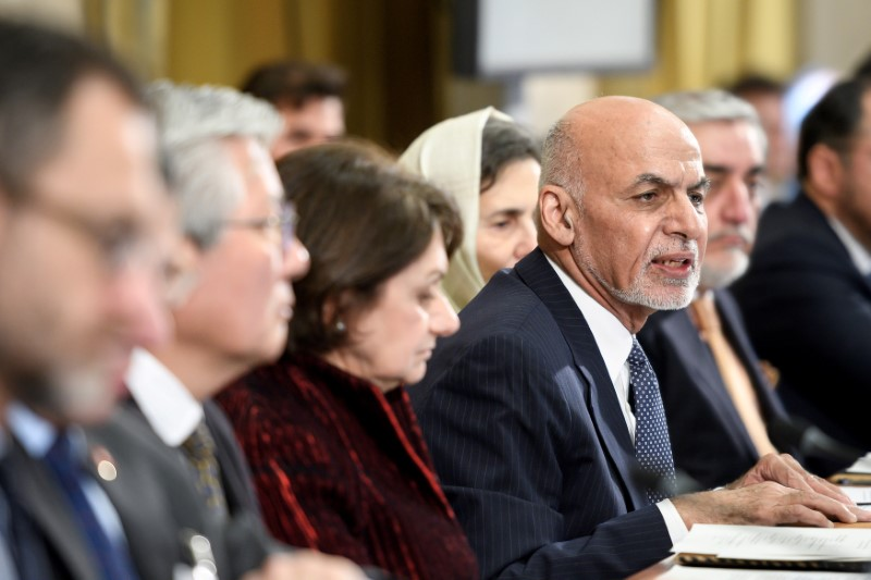 Afghanistan's President Ashraf Ghani (R) delivers a speech during the United Nations Conference on Afghanistan on November 28, 2018 at the UN Offices in Geneva, Switzerland. Fabrice COFFRINI/Pool via REUTERS