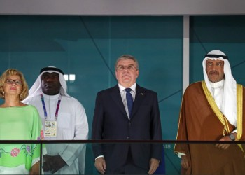FILE PHOTO: 2018 Asian Games - Closing Ceremony - GBK Main Stadium - Jakarta, Indonesia - September 2, 2018 - IOC President Thomas Bach and Sheikh Ahmad AlFahadAl Sabah, president of the Olympic Council ofAsia, attend the ceremony. REUTERS/Athit Perawongmetha