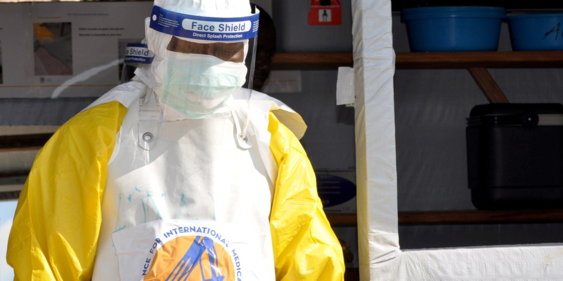 FILE PHOTO: A medical worker wears a protective suit as he prepares to administer Ebola patient care at The Alliance for International Medical Action (ALIMA) treatment center in Beni, North Kivu province of the Democratic Republic of Congo September 6, 2018. Picture taken September 6, 2018. REUTERS/Fiston Mahamba/File Photo