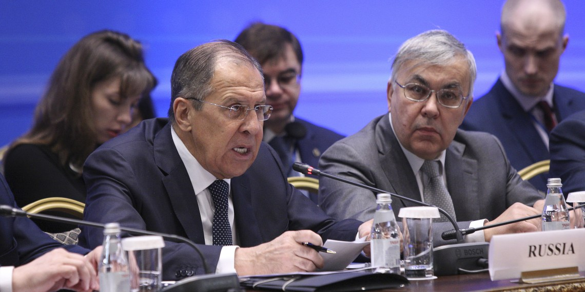 FILE PHOTO: Russian Foreign Minister Sergei Lavrov (L) speaks during the international meeting on Syria in Astana, Kazakhstan March 16, 2018. REUTERS/Mukhtar Kholdorbekov