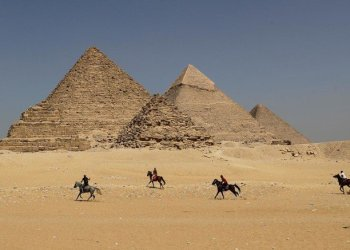 (FILES) In this file photo taken on October 02, 2018 horse riders gallop near the Giza pyramids, on the southwestern outskirts of the Egyptian capital Cairo. (AFP)