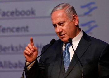 Israeli Prime Minister Benjamin Netanyahu gestures as he speaks during the annual GPO (government press office) New Year's toast in Jerusalem on December 12, 2018. (AFP)