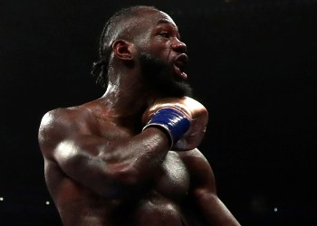 FILE PHOTO: Boxing - Deontay Wilder v Tyson Fury - WBC World Heavyweight Title - Staples Centre, Los Angeles, United States - December 1, 2018  Deontay Wilder reacts after knocking down Tyson Fury  Action Images via Reuters/Andrew Couldridge