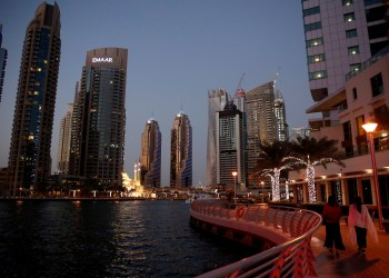 FILE PHOTO: Tourist walk at the Dubai Marina, surrounded by high towers of hotels, banks and office buildings, in Dubai, United Arab Emirates December 11, 2017. REUTERS/Amr Abdallah Dalsh -/File Photo