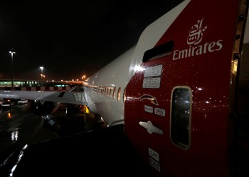 The Emirates airlines logo is seen on the back door of a plane at Dubai International Airport, United Arab Emirates January 8, 2018. REUTERS/Caren Firouz