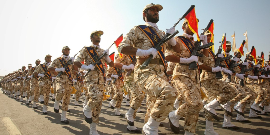 FILE PHOTO: Members of the Iranian Revolutionary Guards march during a parade to commemorate the anniversary of the Iran-Iraq war (1980-88), in Tehran September 22, 2011. REUTERS/Stringer