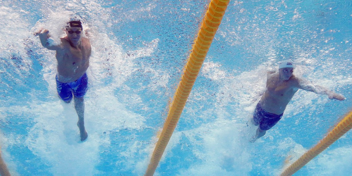 FILE PHOTO: Caeleb Remel Dressel of the U.S. and Vladimir Morozov of Russia compete in Freestyle 50m Semifinal – Budapest, Hungary – July 28, 2017 . REUTERS/Michael Dalder