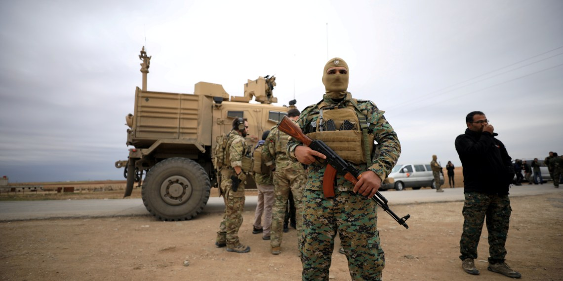 FILE PHOTO: Syrian Democratic Forces and U.S. troops are seen during a patrol near Turkish border in Hasakah, Syria Nov. 4, 2018. REUTERS/Rodi Said