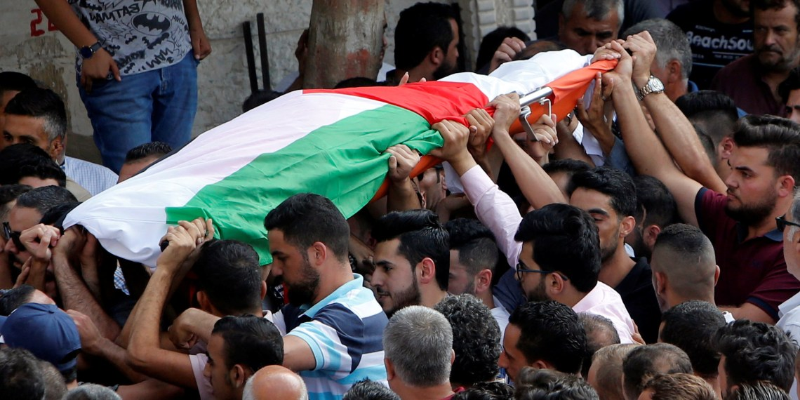 Mourners carry the body of Palestinian woman Aisha al-Rawbi during her funeral in the town of Biddya near Nablus in the occupied West Bank October 13, 2018. REUTERS/Abed Omar Qusini
