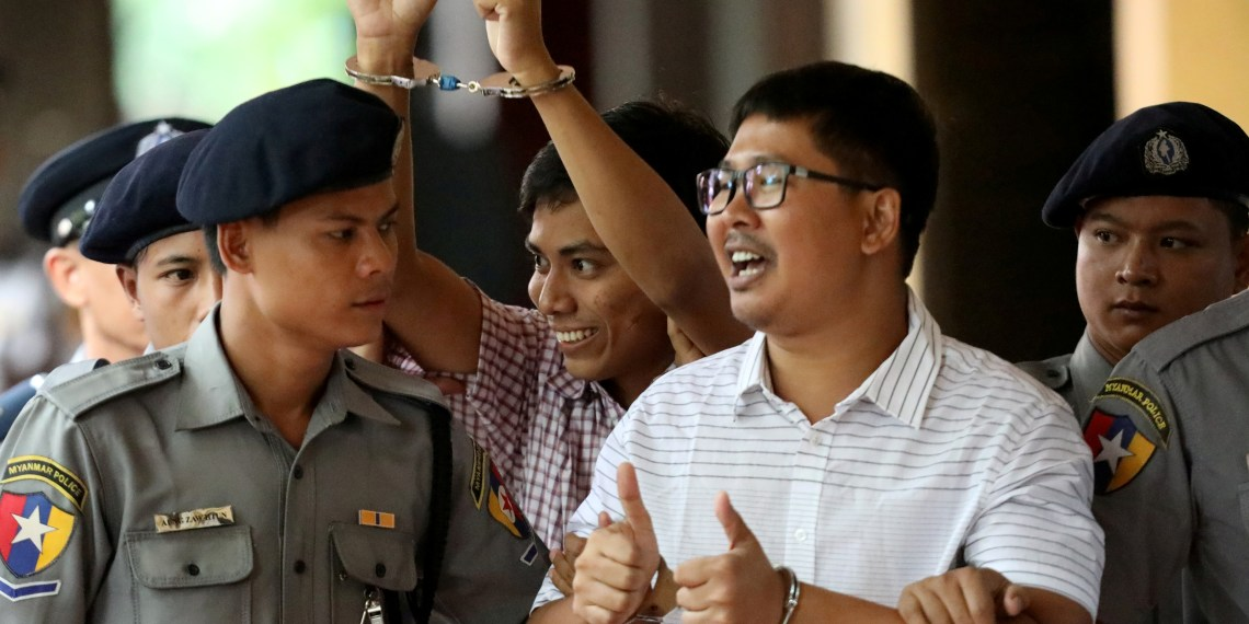 FILE PHOTO: Detained Reuters journalist Wa Lone and Kyaw Soe Oo arrive at Insein court in Yangon, Myanmar August 27, 2018. REUTERS/Ann Wang/File Photo