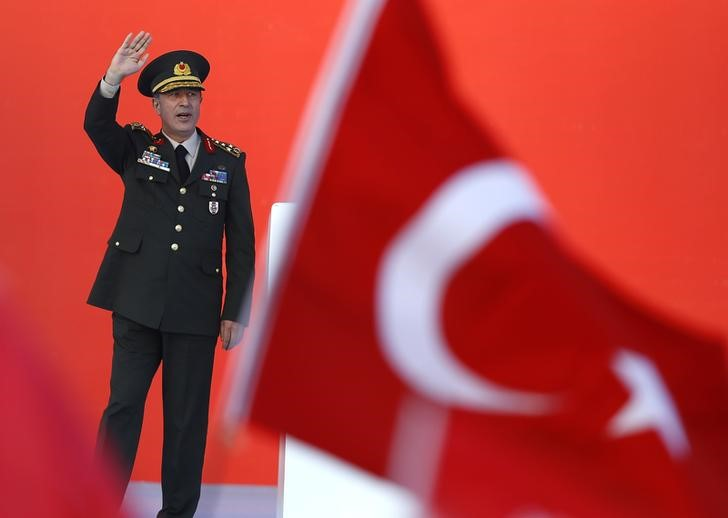 FILE PHOTO:  Turkey's Chief of the General Staff Hulusi Akar greets audience during the Democracy and Martyrs Rally, organized by Turkish President Tayyip Erdogan and supported by ruling AK Party (AKP), oppositions Republican People's Party (CHP) and Nationalist Movement Party (MHP), to protest against last month's failed military coup attempt, in Istanbul, Turkey, August 7, 2016.  REUTERS/Osman Orsal