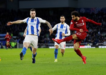 Soccer Football - Premier League - Brighton & Hove Albion v Liverpool - The American Express Community Stadium, Brighton, Britain - January 12, 2019  Liverpool's Mohamed Salah shoots at goal   Action Images via Reuters/Paul Childs