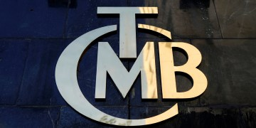 FILE PHOTO: A logo of Turkey's Central Bank (TCMB) is pictured at the entrance of the bank's headquarters in Ankara, Turkey April 19, 2015. REUTERS/Umit Bektas