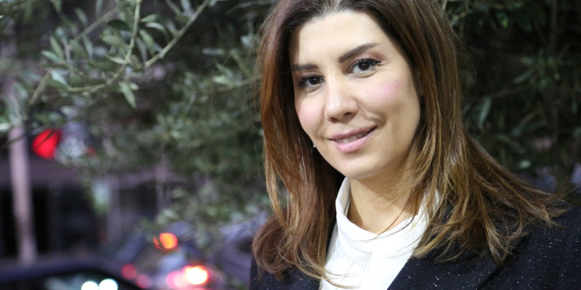 Lebanese MP, Paula Yacoubian poses for a photo in front of her office in Beirut, Lebanon, January 11, 2019. Thomson Reuters Foundation/Heba Kanso