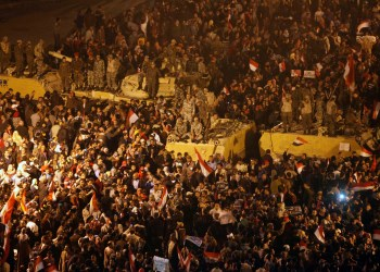 FILE PHOTO: Anti-government protesters celebrate next to soldiers inside Tahrir Square after the announcement of Egyptian President Hosni Mubarak's resignation in Cairo February 11, 2011. REUTERS/Asmaa Waguih