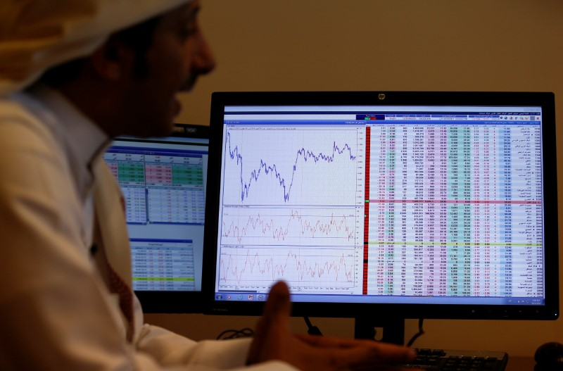 FILE PHOTO: An investor gestures as he monitors a screen displaying stock information in Riyadh, Saudi Arabia, November 6, 2017. REUTERS/Faisal Al Nasser