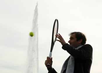 Switzerland's Roger Federer returns the ball to Bjorn Borg of Sweden during a tennis session to promote the Laver Cup tennis tournament on a temporary court on the banks of Lake Geneva in Geneva, Switzerland February 8,2019. REUTERS/Arnd Wiegmann