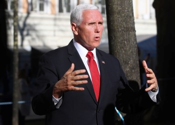 U.S. Vice President Mike Pence speaks outside Hotel Bayerischer Hof during Munich Security Conference in Munich, Germany February 16, 2019. REUTERS/Michael Dalder