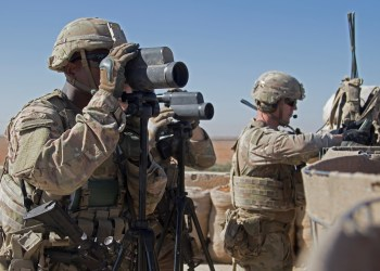 FILE PHOTO: U.S. Soldiers surveil the area during a combined joint patrol in Manbij, Syria, November 1, 2018.  Courtesy Zoe Garbarino/U.S. Army/Handout via REUTERS